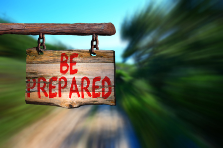 Be prepared motivational phrase sign on old wood with blurred background Stock Photo