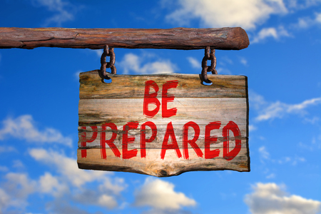 be prepared: Be prepared motivational phrase sign on old wood with blurred background Stock Photo