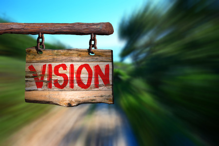 phrase: Vision motivational phrase sign on old wood with blurred background Stock Photo