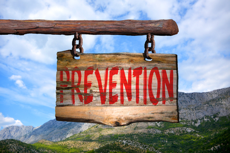 phrase: Prevention motivational phrase sign on old wood with blurred background Stock Photo
