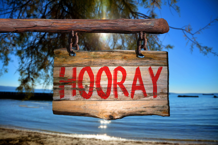hooray: Hooray motivational phrase sign on old wood with blurred background