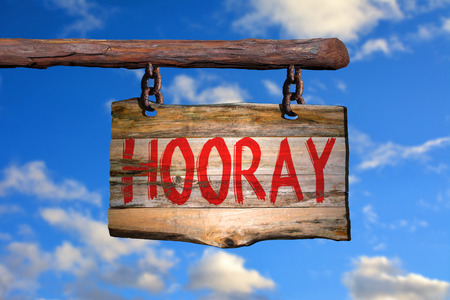 phrase: Hooray motivational phrase sign on old wood with blurred background