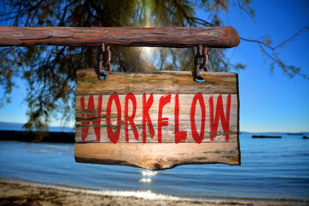 phrase: Workflow motivational phrase sign on old wood with blurred background Stock Photo