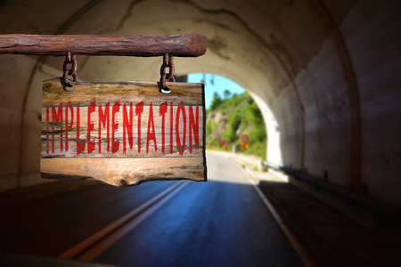 phrase: Implementation motivational phrase sign on old wood with blurred background Stock Photo