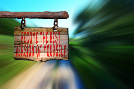 become: Become the best version of yourself motivational phrase sign on old wood with blurred background