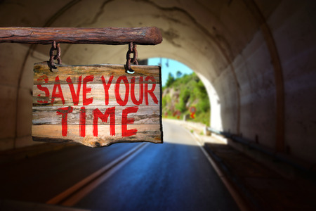 old time: Save your time motivational phrase sign on old wood with blurred background