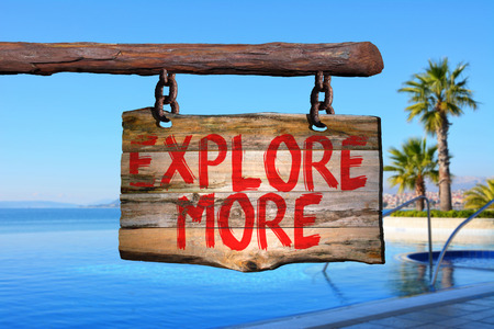 Explore more motivational phrase sign on old wood with blurred background Stock Photo