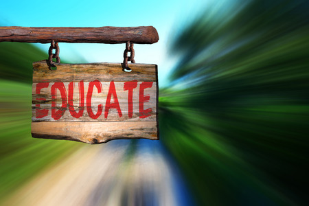 phrase: Educate motivational phrase sign on old wood with blurred background Stock Photo