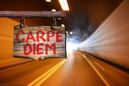 carpe diem: Carpe diem motivational phrase sign on old wood with blurred background
