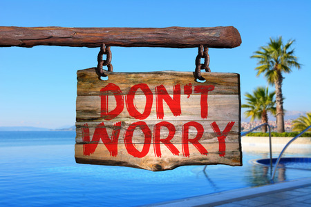 dont worry: Dont worry motivational phrase sign on old wood with blurred background Stock Photo