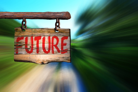 phrase: Future motivational phrase sign on old wood with blurred background
