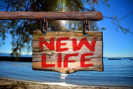 Nouvelle expression de motivation de la vie sur vieux bois avec arrière-plan flou Banque d'images