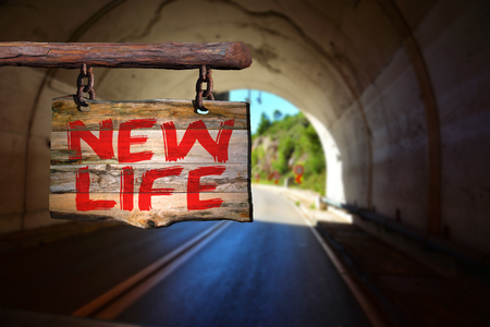 New life motivational phrase sign on old wood with blurred background
