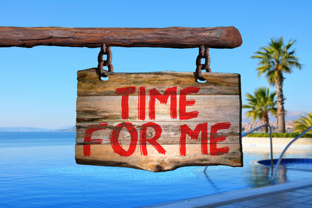 Time for me motivational phrase sign on old wood with blurred background
