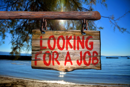 looking for a job: Looking for a job motivational phrase sign on old wood with blurred background Stock Photo