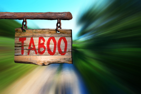phrase: Taboo motivational phrase sign on old wood with blurred background Stock Photo