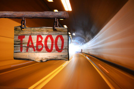 taboo: Taboo motivational phrase sign on old wood with blurred background Stock Photo