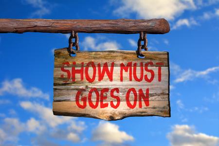 show must goes on motivational phrase sign on old wood with blurred background Reklamní fotografie