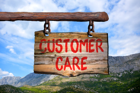 customer care motivational phrase sign on old wood with blurred background Stock Photo