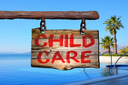 Child care motivational phrase sign on old wood with blurred background
