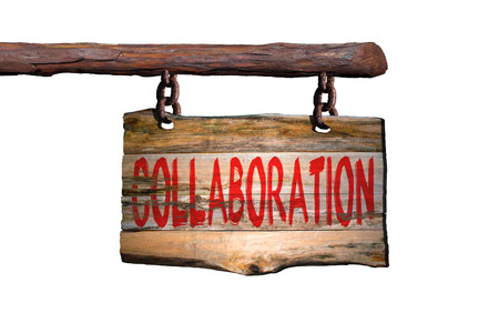phrase: Collaboration motivational phrase sign on old wood with white background Stock Photo