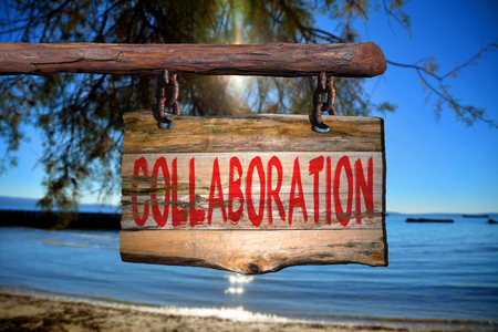 phrase: Collaboration motivational phrase sign on old wood with blurred background Stock Photo