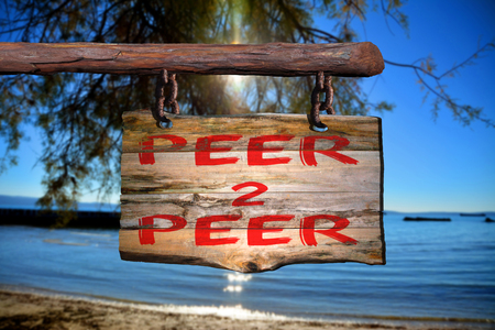 peer: Peer 2 peer motivational phrase sign on old wood with blurred background