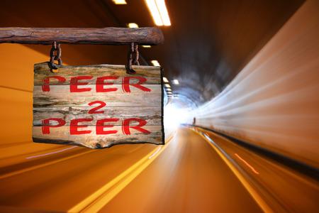 peer to peer: Peer 2 peer motivational phrase sign on old wood with blurred background