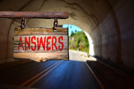 phrase: Answers  motivational phrase sign on old wood with blurred background