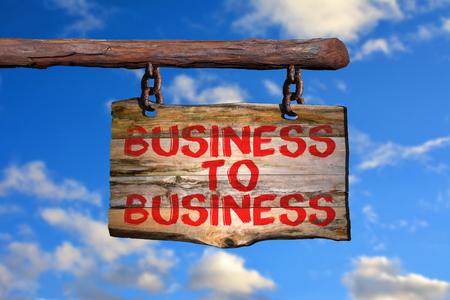 Business to business motivational phrase sign on old wood with blurred background Stock fotó