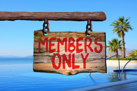 Members only motivational phrase sign on old wood with blurred background Фото со стока