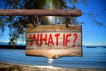 what if: What if? motivational phrase sign on old wood with blurred background