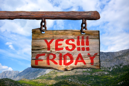 yes!!! Friday motivational phrase sign on old wood with blurred background