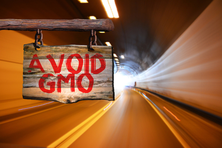 Avoid gmo motivational phrase sign on old wood with blurred background Stock Photo
