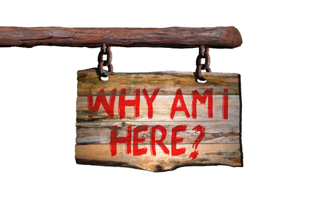 Why am i here motivational phrase sign on old wood with white background Stock Photo