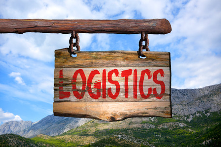 Logistics motivational phrase sign on old wood with blurred background