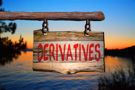 Derivatives motivational phrase sign on old wood with blurred background