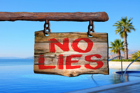 No lies motivational phrase sign on old wood with blurred background Stock Photo