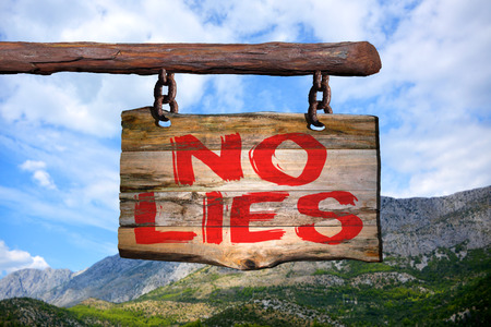 No lies motivational phrase sign on old wood with blurred background