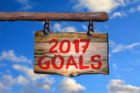 2017 goals motivational phrase sign on old wood with blurred background
