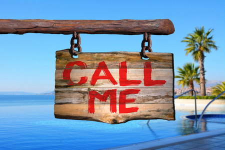 Call me motivational phrase sign on old wood with blurred background