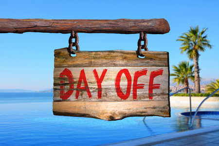 Day off motivational phrase sign on old wood with blurred background Stock Photo