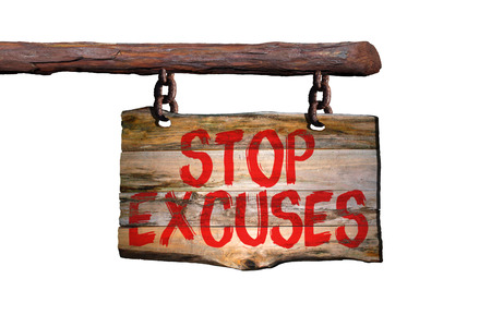 Stop excuses motivational phrase sign on old wood with white background