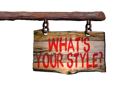 Whats your style? motivational phrase sign on old wood with blurred background