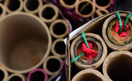 Close-up and top view of partially burned-down fireworks that are left after the Sylvester night or party, with duds in a cardboard box Stok Fotoğraf