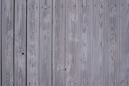 Background from a gray wall made of wooden slats, with structure and texture of wood