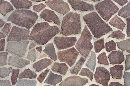 Background, texture and close-up of a wall decorated with flat natural stones Stockfoto