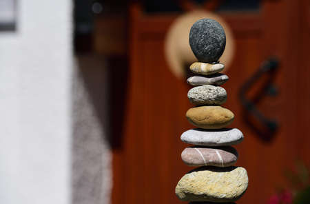 Still life with stones stacked on a doorstep