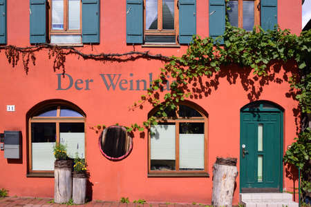 Detail of a facade of a historic building in Donauwoerth, Bavaria, in which an old wine merchant is, with picturesque decoration