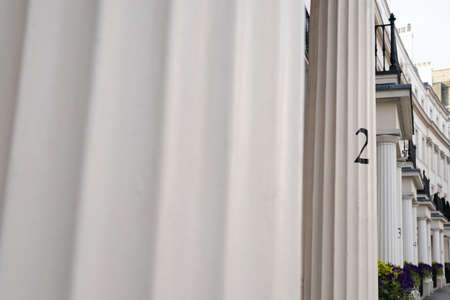 Street of London with numbers on a greek style column